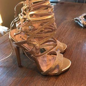 Bebe Gold Lace back Sandals
